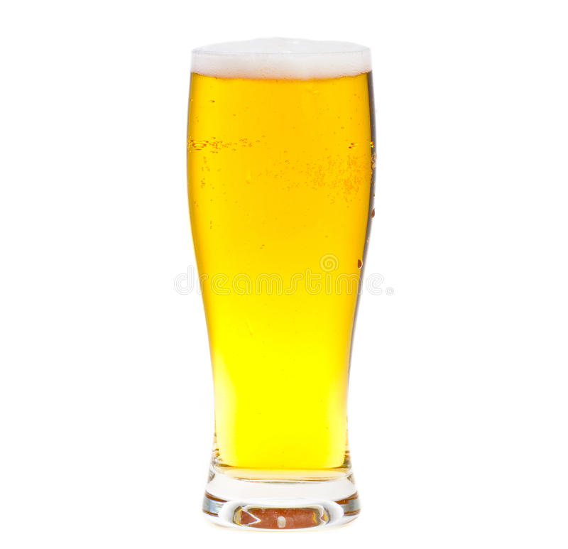 Glass of beer. Close up of beer glass with bubbles and foam isolated on white