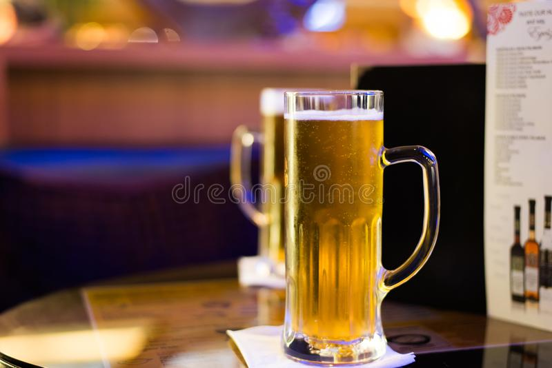 Glass of beer on bar table stock photo