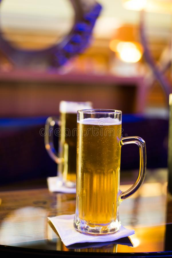 Glass of beer on bar table royalty free stock photography
