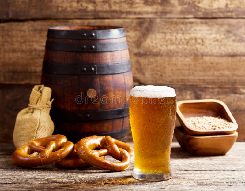 Glass of beer with barrel stock images