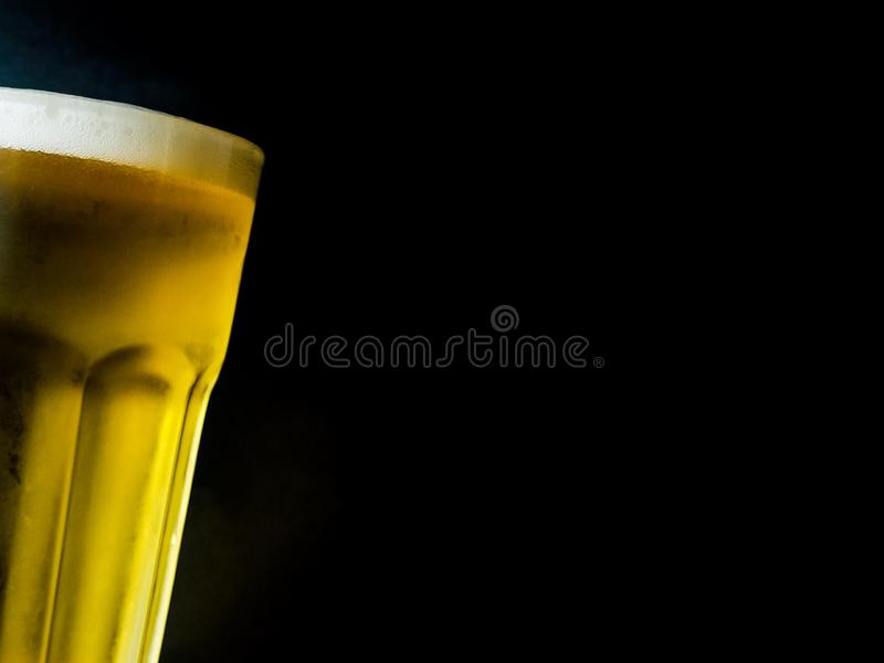 A glass of beer on black background stock photos