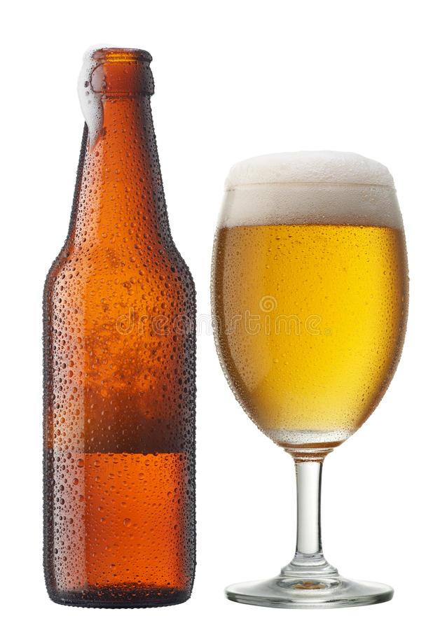 Glass of beer with bottle royalty free stock photography