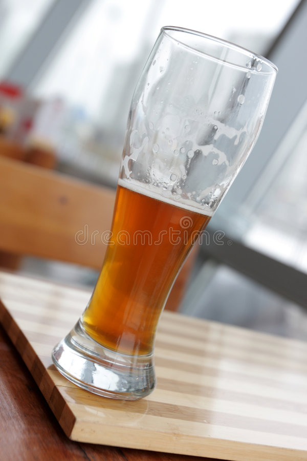 Glass of beer in cafe stock images