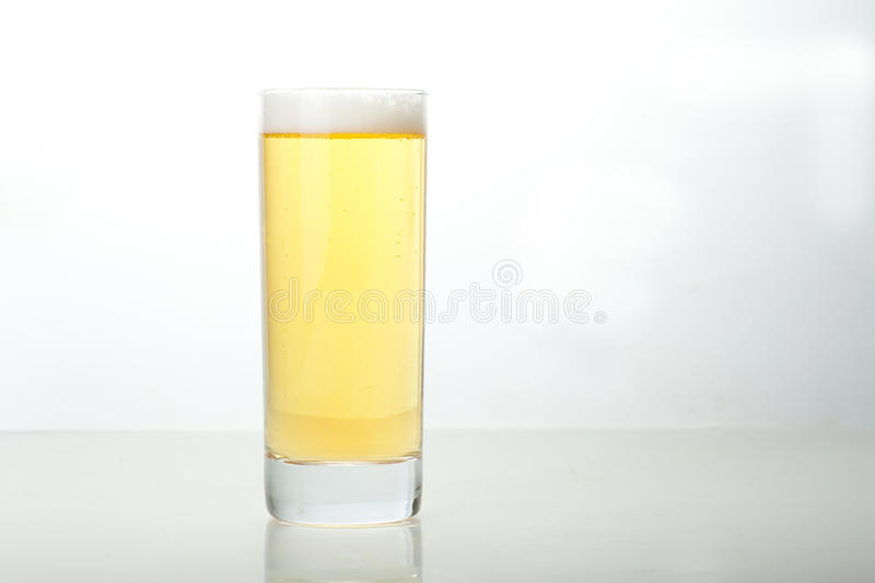 Glass of beer. A close-up of a glass of beer stock photography