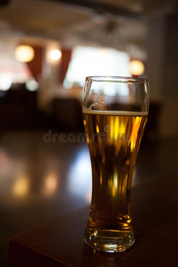A glass of beer on the corner table in the restaurant royalty free stock photo