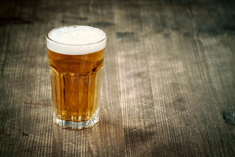 Glass of beer on dark background stock photo