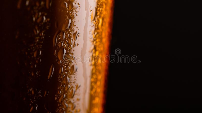Glass of beer with foam on black background closeup royalty free stock photo