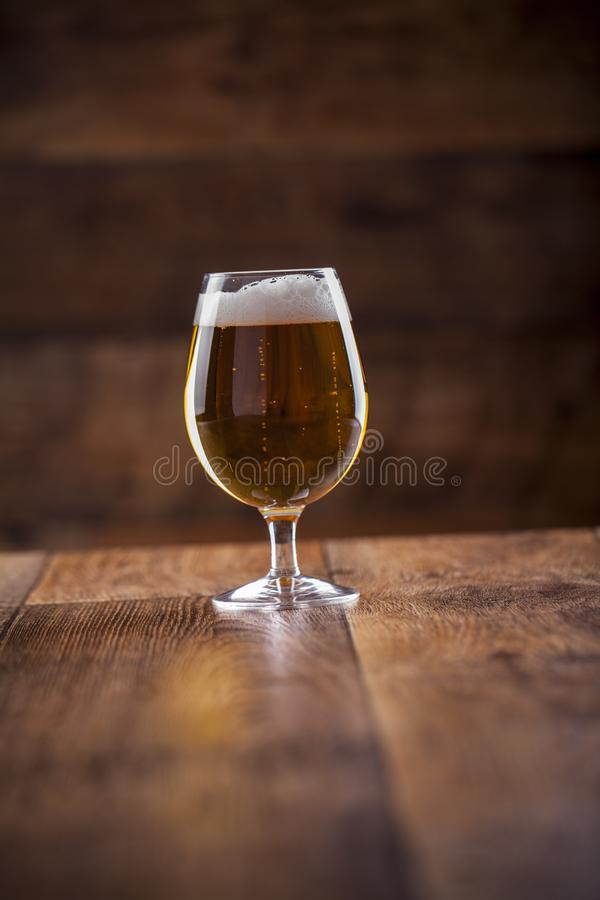 A glass with beer and foam royalty free stock images