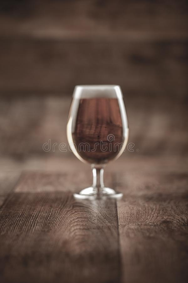 A glass with beer and foam royalty free stock photos