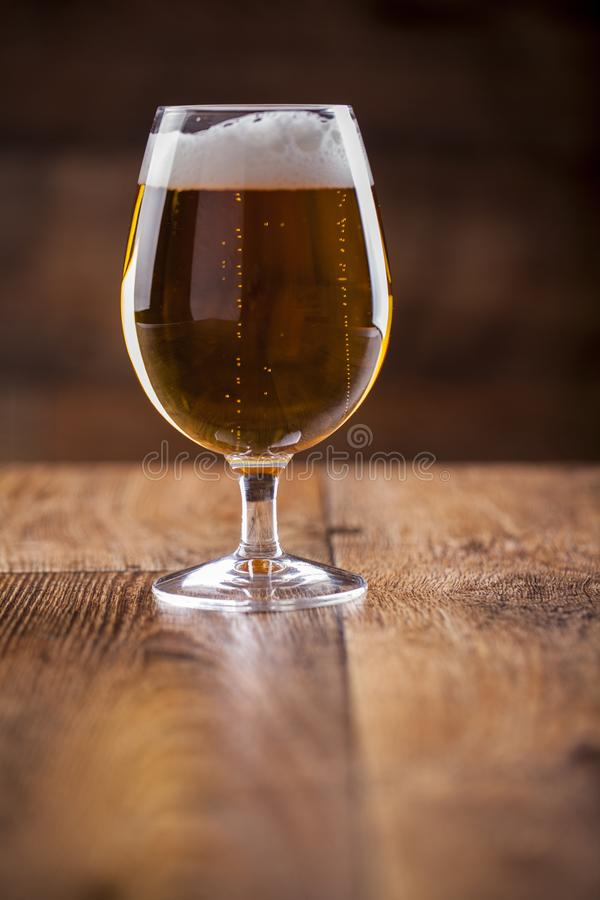 A glass with beer and foam stock images