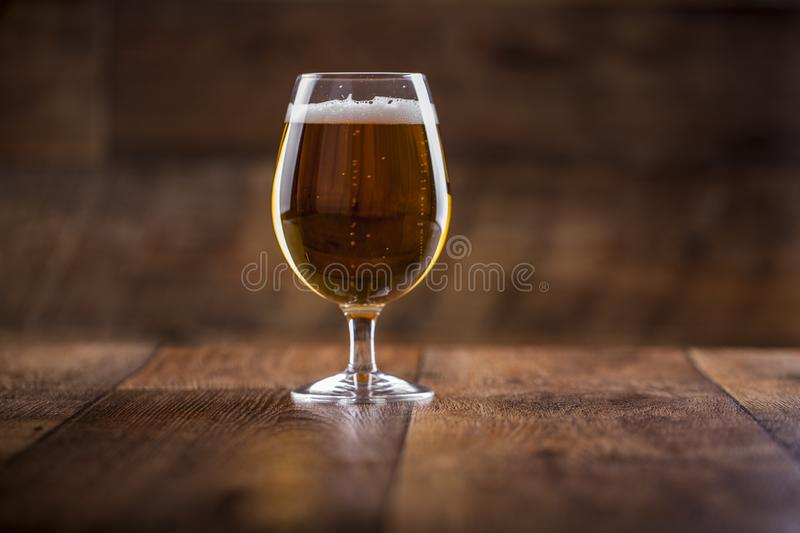 A glass with beer and foam royalty free stock photo