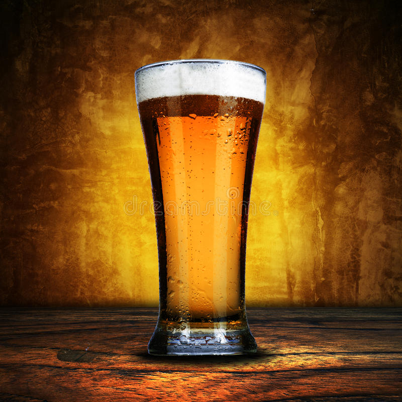 Glass of beer on grunge background stock image