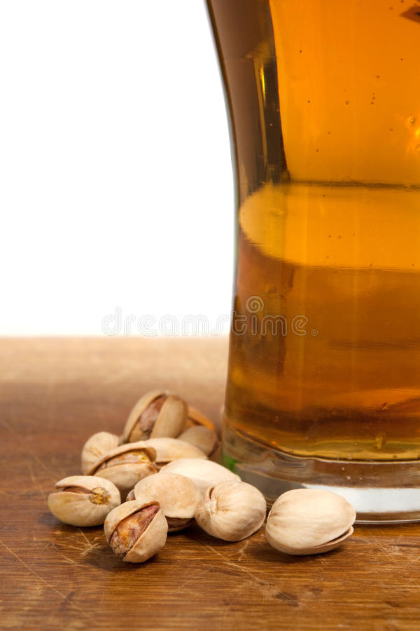 Glass Of Beer And Pistachios Royalty Free Stock Photography