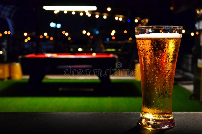 Glass of BEER on Pool Table Background royalty free stock photos
