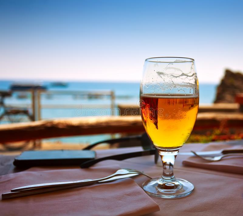 Glass beer sea. Sky summer royalty free stock photography