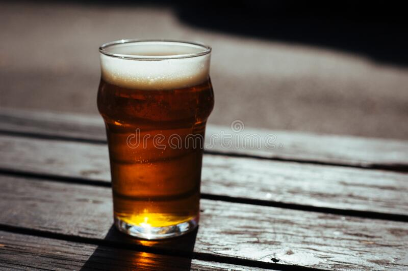 Glass of beer on table royalty free stock image