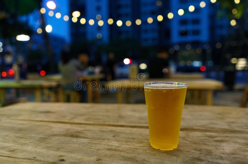 Glass of beer on table royalty free stock images