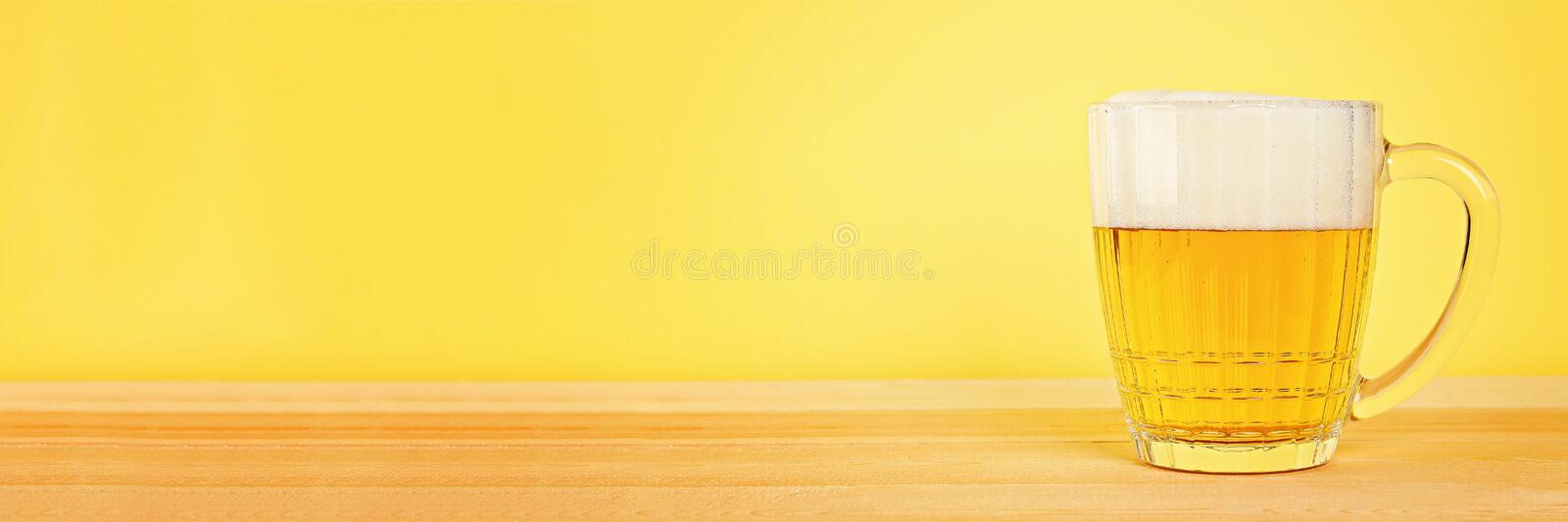 Glass beer on wood background with copy space stock photo