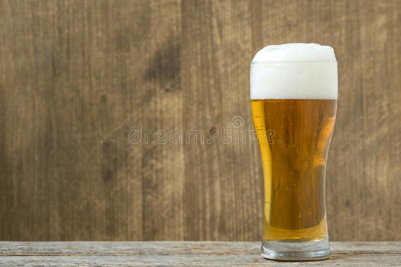 Glass beer on wood background stock photos