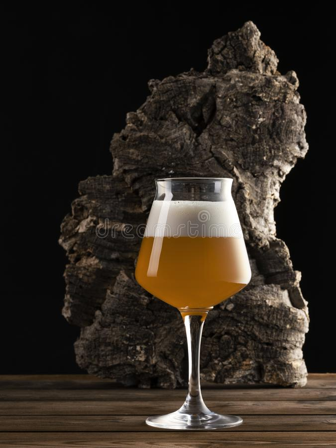 Glass of beer on a wood table stock photo