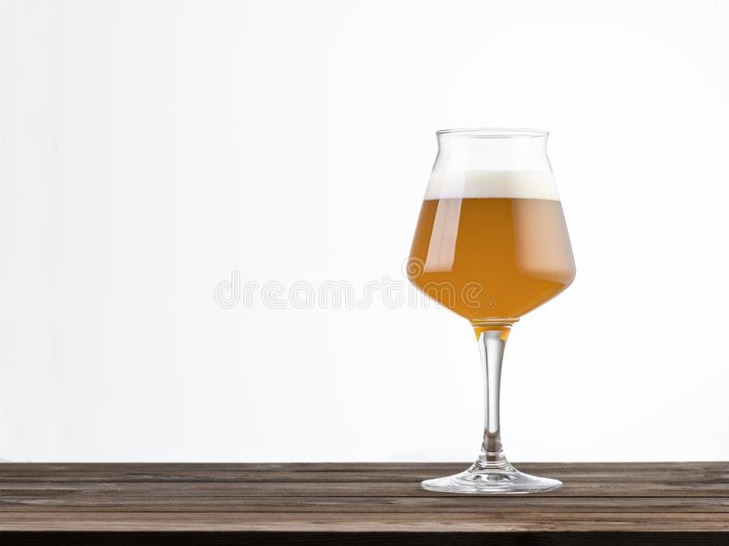 Glass of beer on a wood table isolated on white background royalty free stock photos