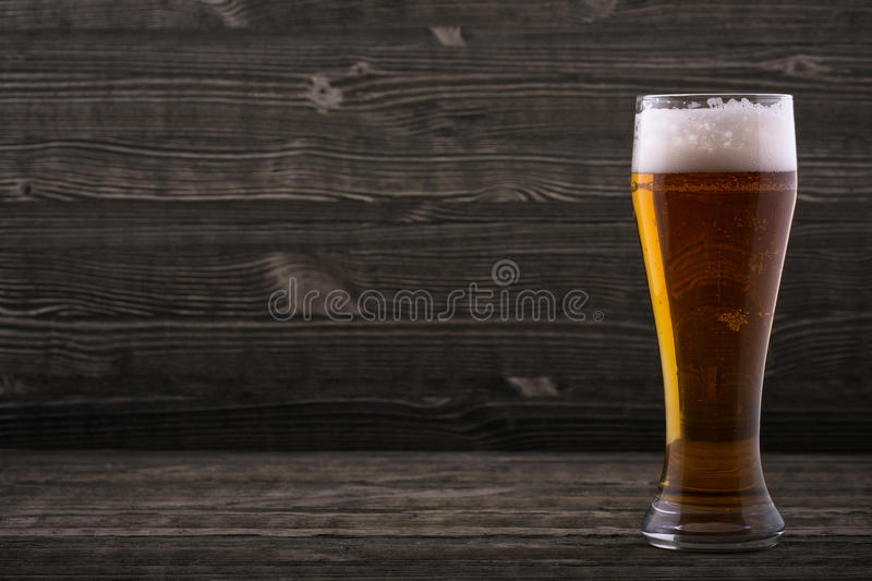 Glass of beer. On a wooden countertop