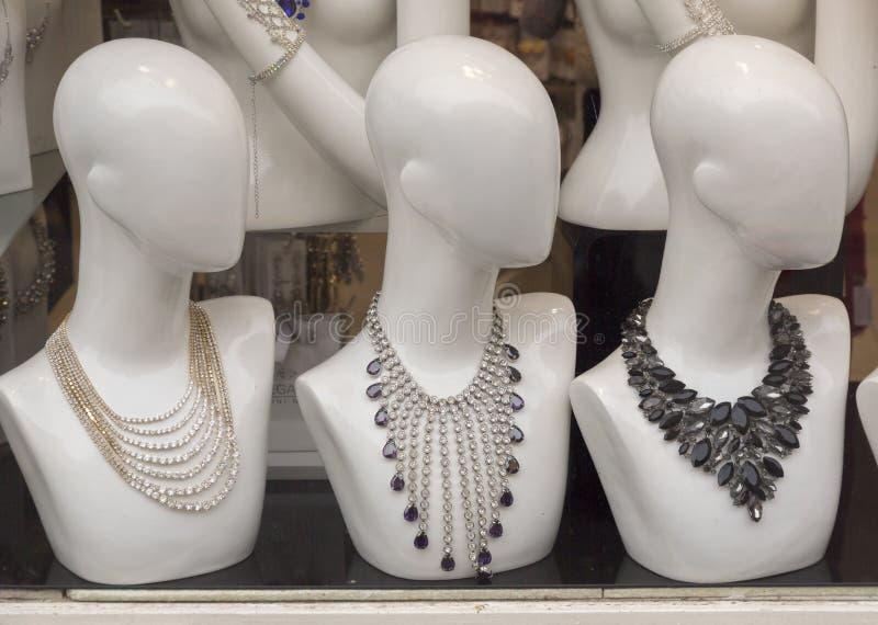 Glass bijou. On the plastic dolls stock photography