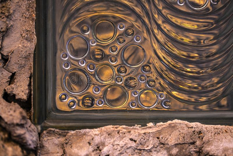 Glass block on the wall abstract. With mood of cement royalty free stock photos