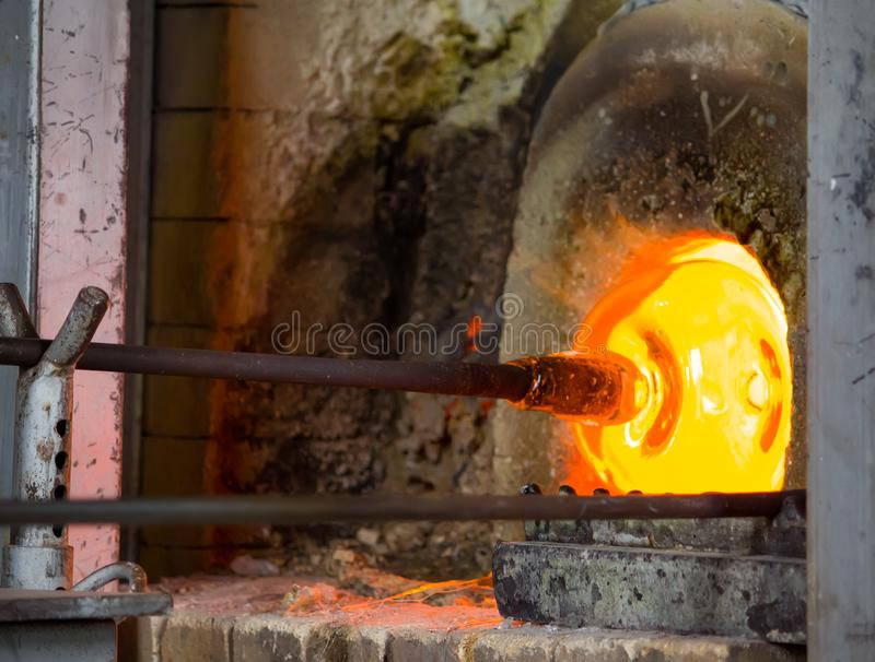 Glass blowing process. In the factory royalty free stock photos