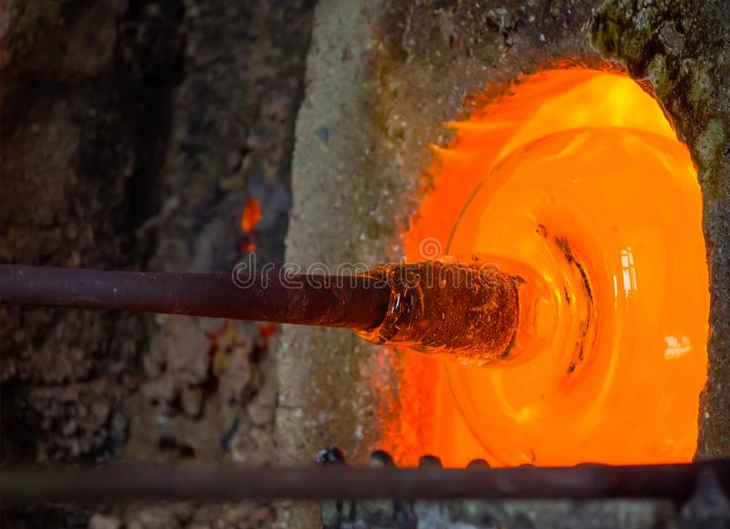 Glass blowing process. In the factory stock photography