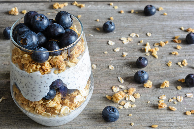 Glass of blueberry yogurt parfait or chia pudding. With berries, granola, oats and chia seeds. healthy breakfast. close up royalty free stock photos