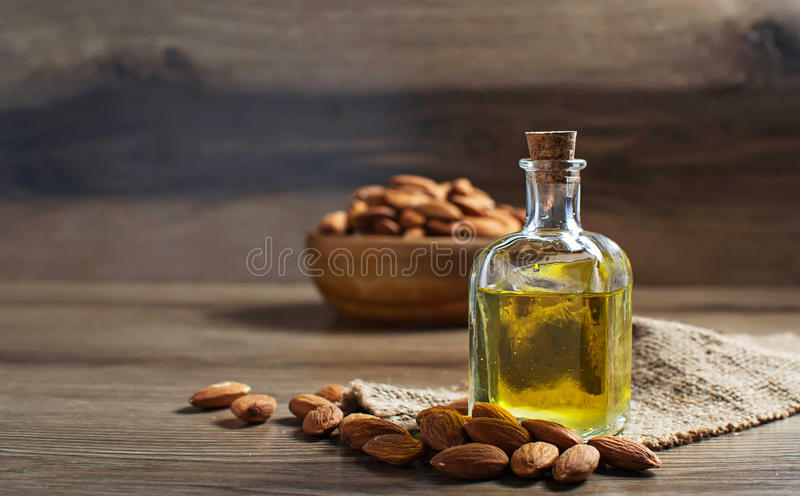 Glass bottle with almond oil stock photography