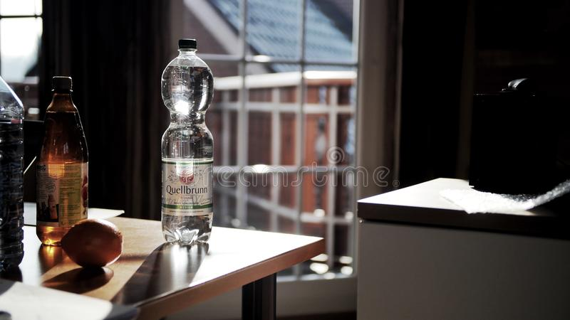 Glass Bottle on Brown Wooden Table stock image