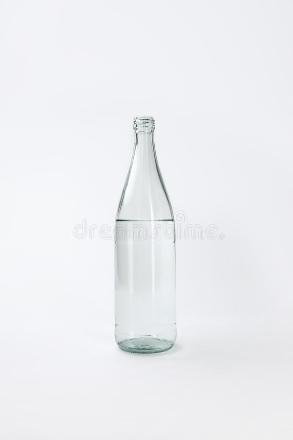 Glass bottle with calm mineral water. Isolated on white stock photos