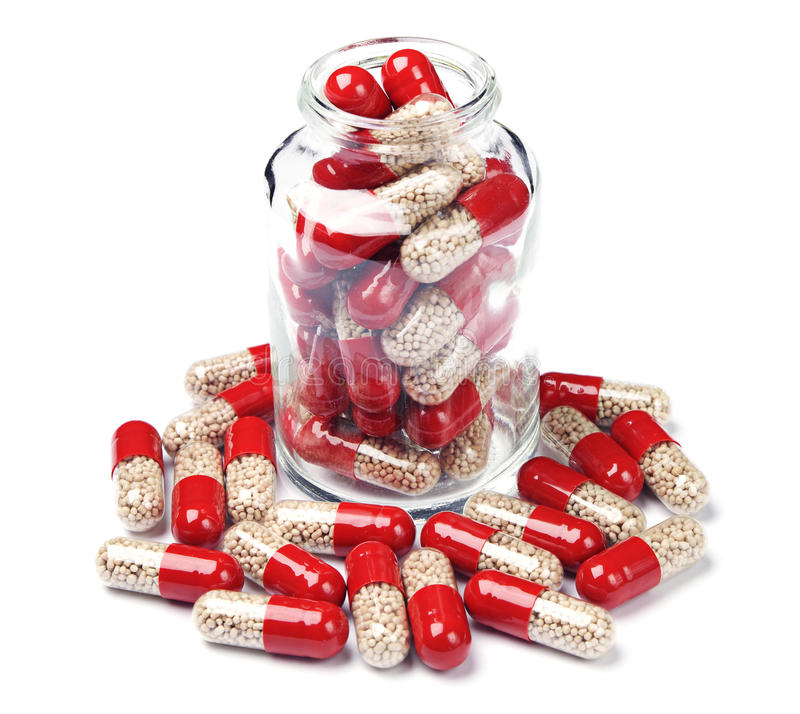 Glass bottle with capsule pills stock image