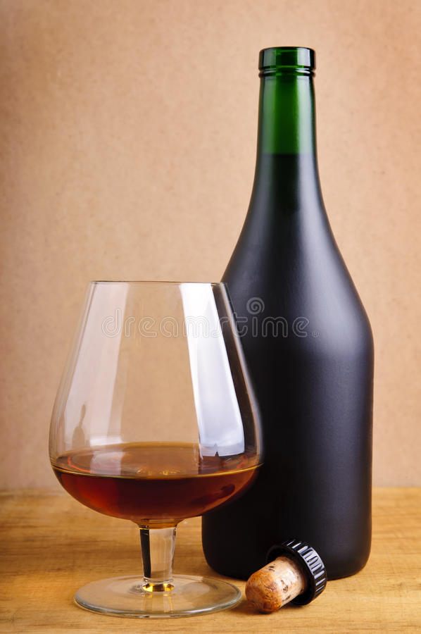 Glass and bottle of cognac royalty free stock image