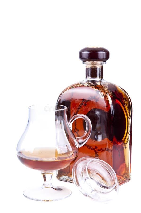 Glass an bottle of cognac stock photos
