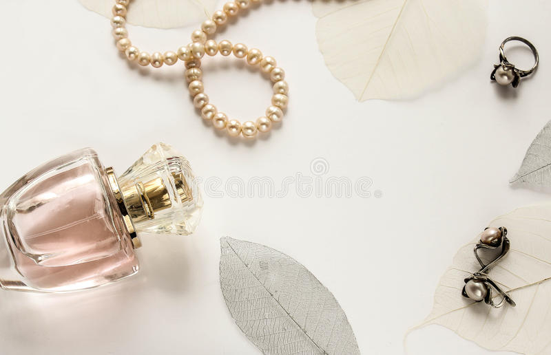 Glass bottle of female perfume on a white background royalty free stock photo