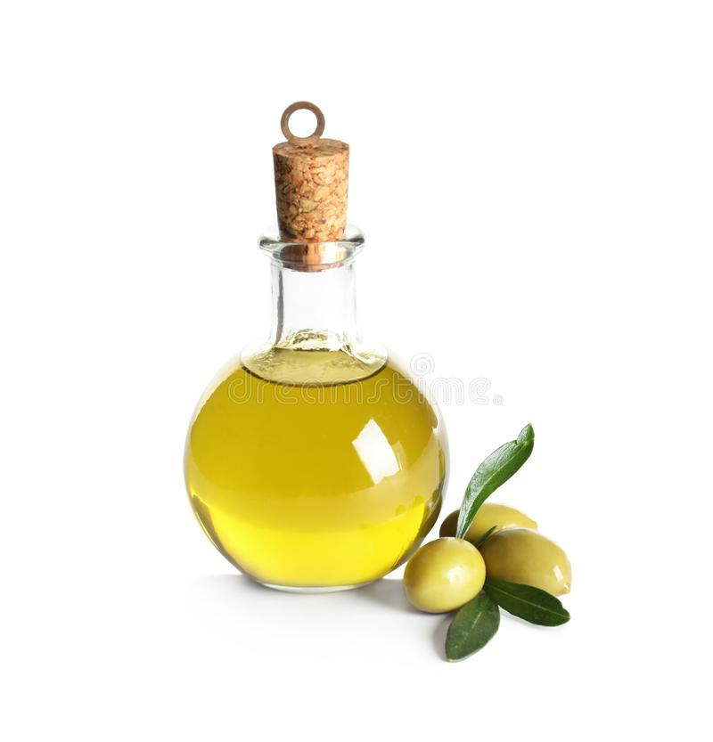 Glass bottle with fresh olive oil royalty free stock images