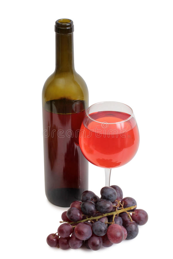 Glass bottle and grapes on white stock photo