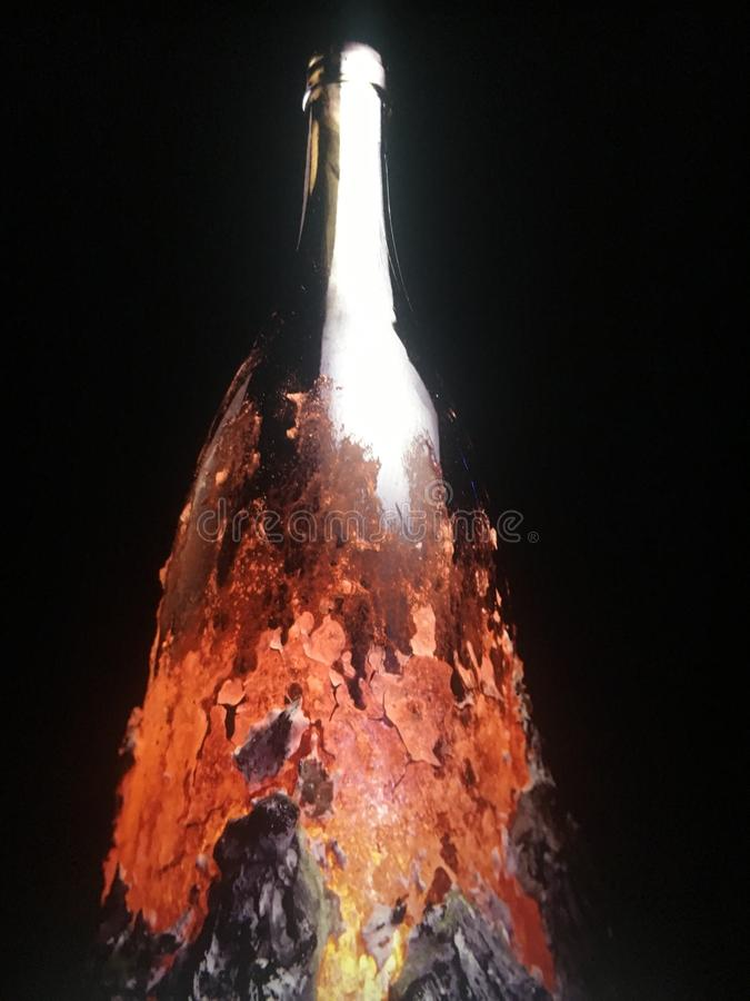 Melted glass effect. Molten glass effect on bottle royalty free stock photo