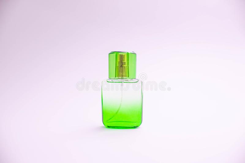 Glass bottle of perfume on white background. Pink, blue, green, black bottle. Women`s and men`s perfume. Aromatherapy, spa. vector illustration
