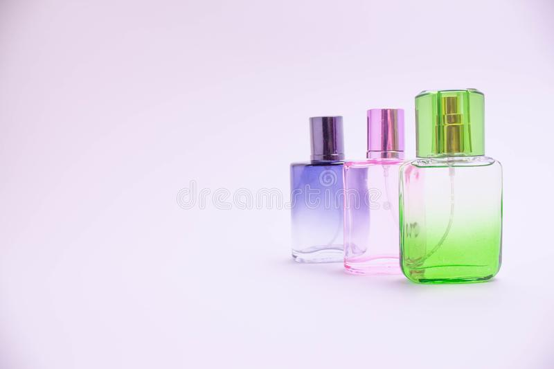 Glass bottle of perfume on white background. Pink, blue, green, black bottle. Women`s and men`s perfume. Aromatherapy, spa. stock illustration
