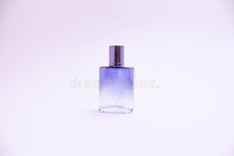 Glass bottle of perfume on white background. Pink, blue, green, black bottle. Women`s and men`s perfume. Aromatherapy, spa. stock photos