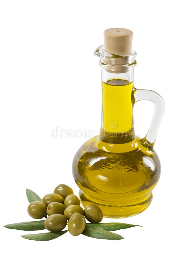 Glass bottle of premium olive oil and some olives stock photo