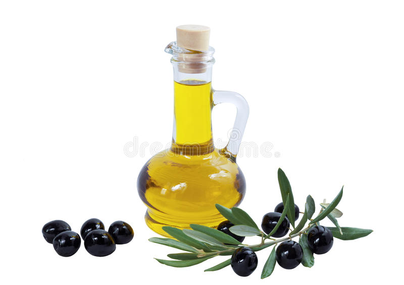 Glass bottle of premium olive oil and some ripe olives stock image
