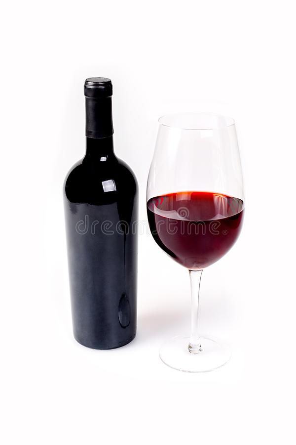 Glass And Bottle Of Red Wine On White stock photos