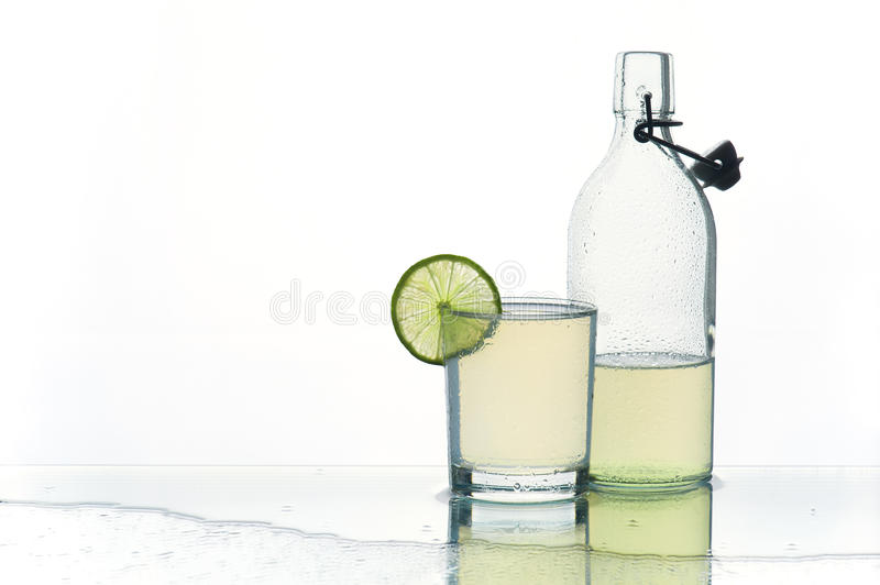 Glass and bottle with refreshment lemonade stock images