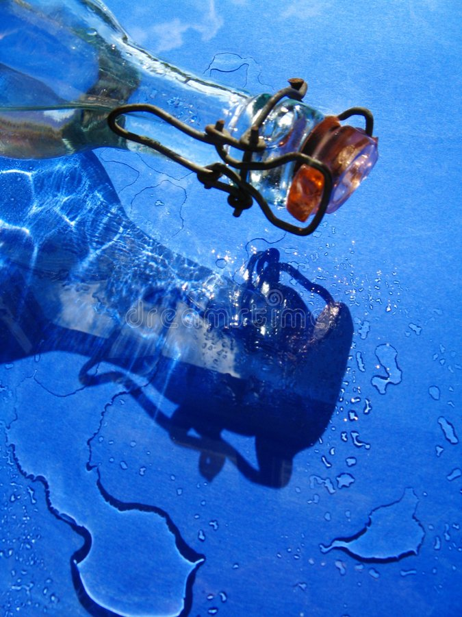 Glass bottle and water royalty free stock photo