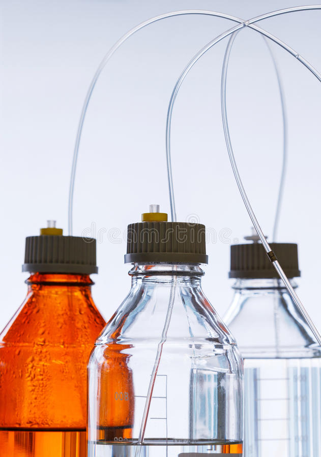 Free Glass Bottle With Plastic Hose Royalty Free Stock Image - 66214036